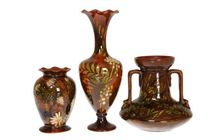 LINTHORPE POTTERY THREE VASES DECORATED WITH FOLIAGE, NOS. 1618, 957 AND 1636, the first with frilled rim, possibly decorated by Florence Minto; the second with twin handles and Henry Tooth monogram; and the third of Classical shape with frilled rim. (3)