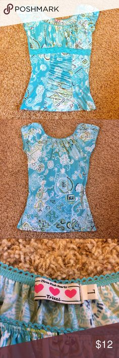 Blue Paisley Blouse Very cute paisley-like top that is very flattering. It has ruching by the tummy area and chest with lace underneath the chest. Also it has blue  lace-y edging on the arms and neckline. No stains or tears, great condition. Tops Blouses