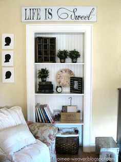 I love that saying. I love these shelves and I love those sweet wall hangings.