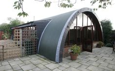 Built as a barrack for soldiers in World War Two using corrugated iron sheeting and bricks, this Nissen hut was transformed into a modern home by owners Ann Lewis and her husband. It was put on the market for nearly £500,000 in October 2006. Picture: Rex Features