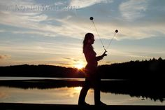 A beautiful picture I took of my friend Chrissy spinning poi at sunset. It's from my blog with a few other cool photos I took. :)