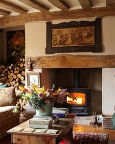 I tell you I'd rather have a wood burning stove than a fireplace. I love this country cottage living room and the log storage! Style Cottage, English Cottage Style, English Country Cottages, English Country Decor, Cozy Cottage, English Cottage Decorating, English Cottage Interiors, Cottage Lounge Ideas, French Country