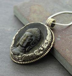 Dharmashop.com - Hand Carved Onyx Buddha Pendant , $208.00 (http://www.dharmashop.com/hand-carved-onyx-buddha-pendant/)