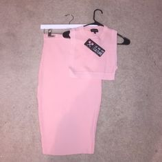 Pink skirt set Brand new skirt and top set. So cute but too small for me. Ribbed material. Skirt features back split. Top features cut out back and sides. Brand: Christina Milian's clothing line We Are Pop Culture We Are Pop Culture Dresses