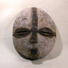 white tribal mask to represent the tribesmen who kidnapped Ann as a sacrifice to Kong. Round Kifwebe Mask