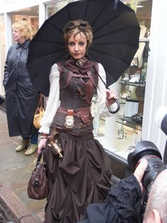 Woman in Whitby Goth Weekend april 2014. I like her outfit! (but, not the props)