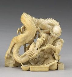 An ivory okimono of a dragon having his teeth examined Meiji Period, Signed Nimin/Futsumin
