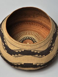 Lidded Basket, made by Elizabeth Hickox (Karuk/Wiyot) (detail)  Detail of lidded basket with knob handle made by Elizabeth Hickox (Karuk/Wiyot), circa 1913. Stacked wood design; plain twined; 3-strand twine; beargrass; maidenhair fern. The Caroline Boeing Poole Collection  (Southwest Museum of the American Indian, 811.G.1460AB)  On display at The Autry until May 6, 2012