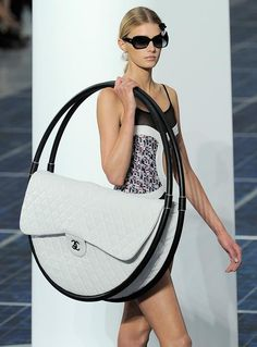 Chanel hula hoop bag (not quite sure how wed get it on the tube but we love it all the same) http://fashionbagarea.blogspot.com/  #chanel #handbags #bags #fashion women chnael 2015 bags are under $159