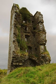 Cloondooan Castle ruins, Ireland - A partially-ruined 16th-century castle, or tower house. It had been a fortress of great strength. In A.D. 1586, The castle was under seige and Mahon, the owner, was killed. His people surrender and the western side of the Castle was then razed to the ground.