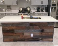 Peel and stick wood flooring underneath a kitchen bar! Total cost ...