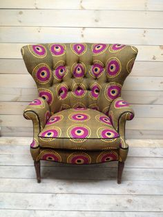 Mid Century Fanback Armchair Upholstered in Olive and Magenta African Dutch Wax Cloth. $1,250.00, via Etsy.