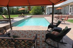 Fiberglass saltwater pool by Dolphin Pools of West Monroe LA.  Royal Fiberglass Pools of Viking Pools Trilogy Pools. Spillover tanning pool with salt water system Pentair ozone system Glacier pool cooler