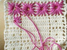 Needle weaving in crochet - this is so nice! make poinsettas of red in the middles on off white squares, add centers of lime green and french dots of yellow ontop of the green add some leafs...viola Christmas afaghan