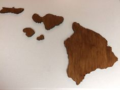 Large Wooden Hawaiian Island Chain Wall Art. Hand crafted with ALOHA and MADE IN HAWAII. Ships directly from O'ahu, Hawaii. This product is made from knotty pine and is hand-crafted and designed to accurately depict the eight major Hawaiian Islands - Kaua`i, Ni`ihau, O`ahu, Moloka`i, Lana`i, Maui, Kaho`olawe, Hawai`i. Once the wood is carefully cut, each island is sanded, stained, and varnished for a smooth finish. All eight islands are included, along with mounting tape. The largest…