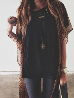 Blue wash skinnies, loose fit black T and sheer leopard kimono. Layer bracelets, necklaces & rings-keeping with the boho vibe...