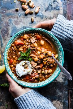 Crockpot Moroccan Lentil and Chickpea Soup - colorful veggies, flavorful spices, all thrown into the crockpot. Come home to heavenly! @halfbakedharvest.com