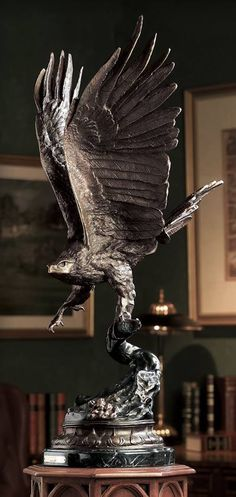 """This masterful bronze Large Eagle Sculpture has been painstakingly handcrafted from the finest materials to give the bronze bird an astonishing lifelike appearance. The finish is then hand rubbed several times for the perfect ending. Standing a proud 32"""" high with a wing span of 14"""".  http://www.creationsandcollections.com/p/large-bronze-eagle-sculpture-lk409  #memorialday#usa#america#merica#corporategifts#americanmade#patriot #patriotic #america#americaproud#wethepeople"""