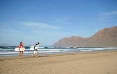 And surfing in Caleta de Famara, Lanzarote, Las Islas Canarias (the Canary Islands), Spain Paradise On Earth, Canario, Canary Islands, Places Ive Been, Surfing, Beach, Water, Holiday, Travel