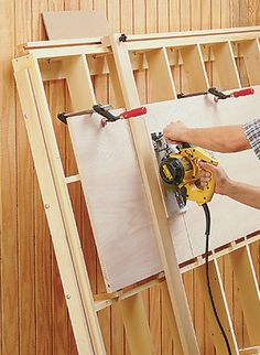 It's easy to cut sheet goods down to size with this tilt-out panel cutting guide. Woodworking Saws, Woodworking Workshop, Custom Woodworking, Woodworking Projects Plans, Woodworking Basics, Lumber Storage Rack, Plywood Storage, Woodsmith Plans, Panel Saw