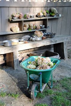 mud kitchen- I like the shelves on the fence and table that feels so very open ended for play. Diy Outdoor Kitchen, Outdoor Fun, Backyard Playground, Playground Ideas, Backyard Games, Backyard Projects, Mud Pie Kitchen, Outdoor Nursery, Outdoor Play Spaces