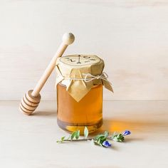 Large honey jar with wooden dipper