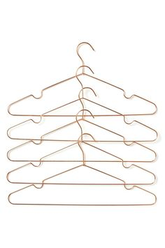 Spice up your wardrobe with our fabulous rose gold wire coat hangers.  Comes in a pack of 5. Composition: 100% Metal  Dimensions: 40cm L x 19cm H