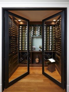 The double glass doors on this wine cellar add a sort of elegance to the libations. Cave A Vin Design, Wine Cellar Design, Wine Cellar Modern, Glass Wine Cellar, Home Wine Cellars, Home Wine Bar, Double Glass Doors, Home Bar Designs, Wine Wall
