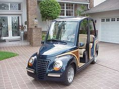 The 2004 Lido ' Woody' neighborhood electric golf cart decked out to resemble Chrysler PT Cruiser is far cry from the original electric golf carts of the past~