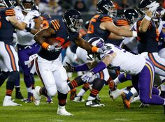 Monday Night Football: Vikings vs. Bears:   20-10, Bears  -     Mon. October 31, 2016. Chicago Bears running back Jordan Howard (24) runs as Minnesota Vikings defensive end Brian Robison (96) defends during the first half of an NFL football game in Chicago, Monday, Oct. 31, 2016.