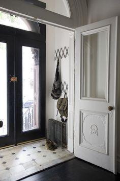 coat rack (outside of hallway closet door)