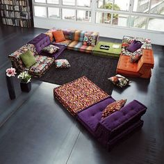 Triadic scheme using purple - colors are really vibrant in this scheme! This is a modular sectional sofa as well...