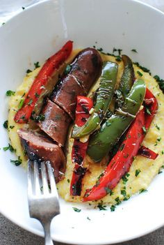 creamy polenta with chicken sausages. This polenta recipe was amazing! Perfect creamy cheesy version. I didn't use chicken sausage but pork instead, and only used red peppers. You could also throw in some yellow as well. Overall a pretty easy one dish meal.