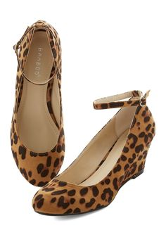 City Savvy Wedge in Leopard. Show those out-of-towner friends of yours that you know this city as well as you know fun fashion by leading the way in these leopard-print wedges. #tan #modcloth