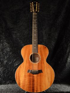 Taylor K-65 (1998) : Discontinued model. Figured Koa top, back and sides.