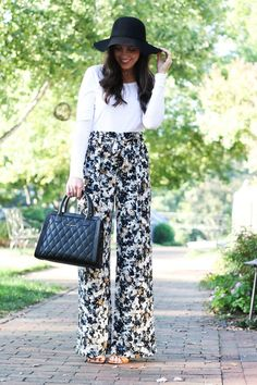 Floral fall print | high waisted palazzo styled pants | @verabradley quilted bag | @LOFT long sleeve white tee | black floppy hat for fall