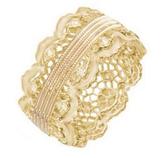 An 18 karat yellow gold lace band with three rows of milgrain around the center and scalloped edges. #customring #engagementring #bridetobe #ashleymorgandesigns #goldring #sanfrancisco #losangeles #designerjewelry #luxuryliving #ring #jewelry #weddingplanning