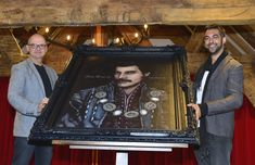 Graham Jenkins of Henry Tudor House with the Freddie Mercury portrait and artist Adam Birch