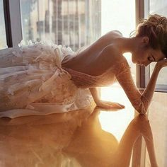 Wedding dress with open back and long sleeves