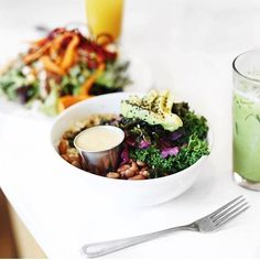 Healthy lunch inspo from @rrayyme. Super easy to whip up especially if you have quinoa or rice cooked left over. Kale/greens quinoa brown rice veggies sprouts and avocado.. paired with a coconut milk matcha latte.  Proper fuel