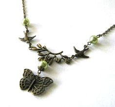 Bronze sparrows necklace light olive green pearls jewelry branch and butterfly necklace vintage look via Etsy