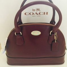 LAST CHANCE Mini Cora Dome Cherry (Burgundy) Color with Gold Hardware  Leather with fabric interior Zip top closure Interior zip pocket Includes longer strap for shoulder or cross body wear. PRICE IS FIRM, NO TRADES Coach Bags