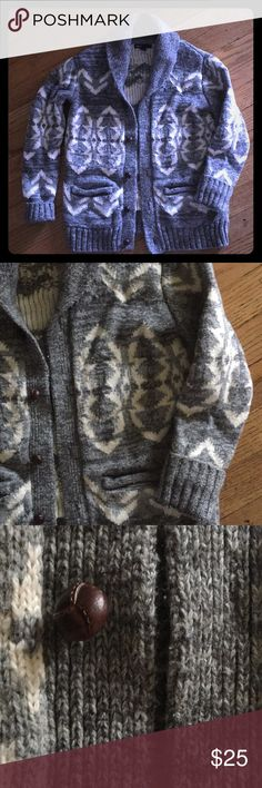 Boys gap sweater Cozy and stylish knit sweater with buttons. Perfect used condition. 60% cotton, 30% nylon, 10% wool. Medium 8/9, I think it runs a bit small, mine wore it at 7. Gray with a blueish hue, and off white, not truly white. GAP Shirts & Tops Sweaters