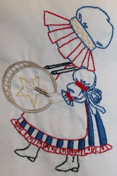 Celebrate! A Sunbonnet Sue embroidered by Shawnda.