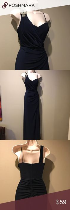 XSCAPE DARK BLUE EMBELLISHED GOWN, size 4 In excellent preowned condition, XSCAPE dark navy blue down with shoulder embellishment. Off the shoulder machine in front and in back – figure flattering, fully lined. Size is 4 Xscape Dresses One Shoulder