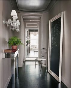 Floor mirror frame as chalkboard at entry