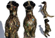Sean Avery repurposes old broken cds and makes them into animals.