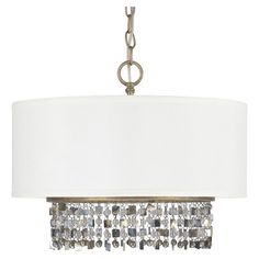 Cast a warm glow in your living room or den with this lovely pendant, showcasing draped accents and a brushed gold finish.  Product:...