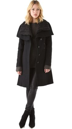 not easy to stay warm and stylish in chicago. This could help:: Mackage Asymmetrical Coat
