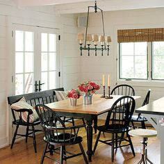 """From an article titled """"Lakeside Cabin Makeover"""" found on realestate.msn, love the bench seat and dining light."""